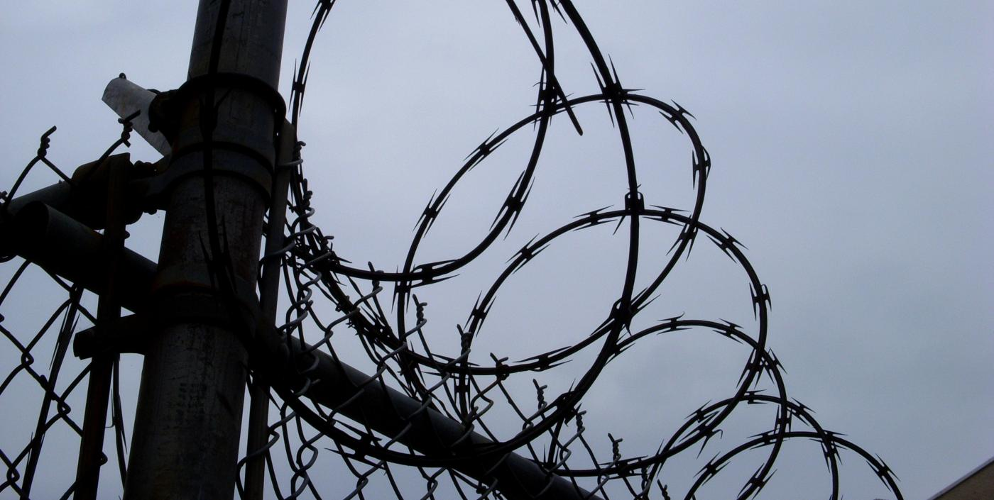 Uninviting razorwire fence.