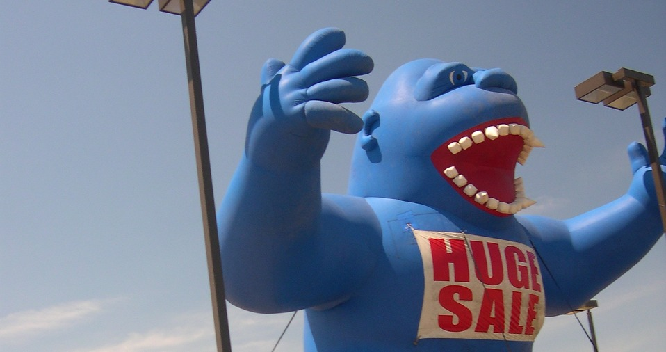 Blue Gorilia with Huge Sale sign.