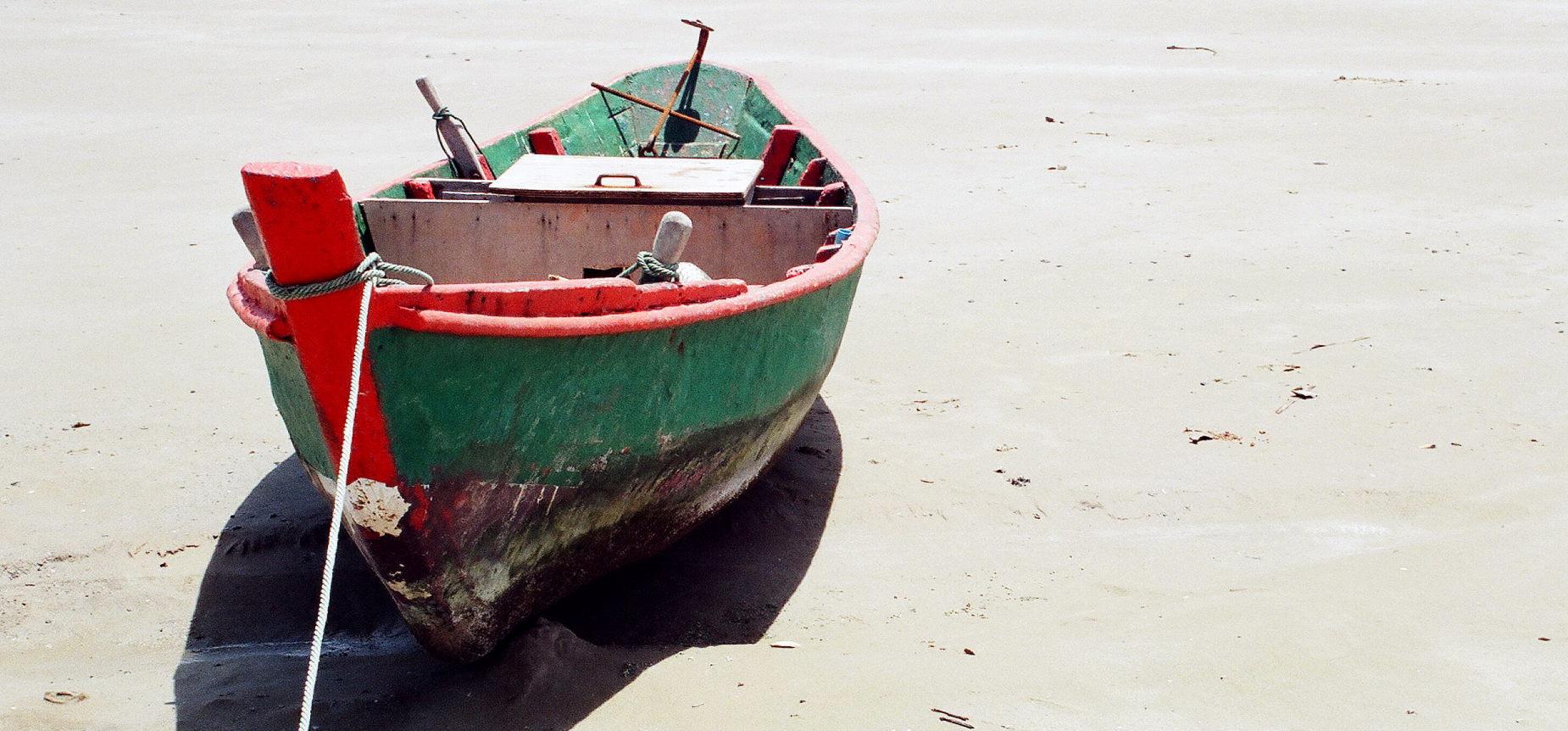 Empty green boat